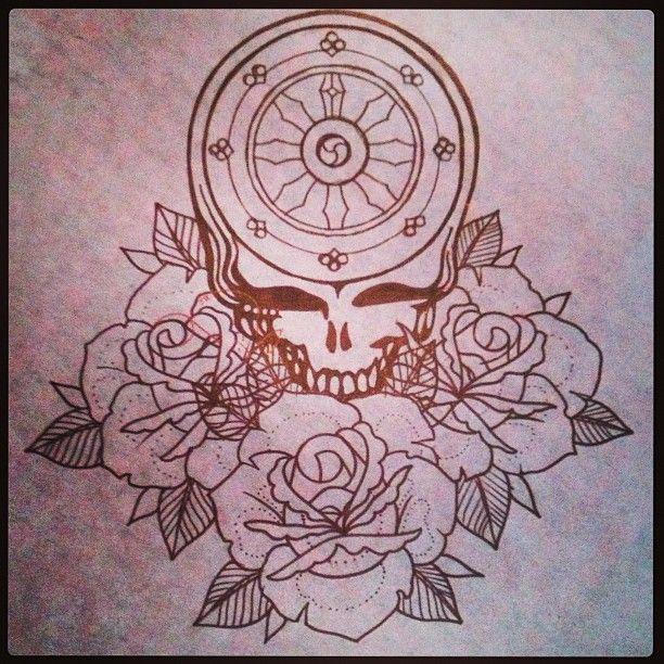 dharma wheel is shown with lotus flowers