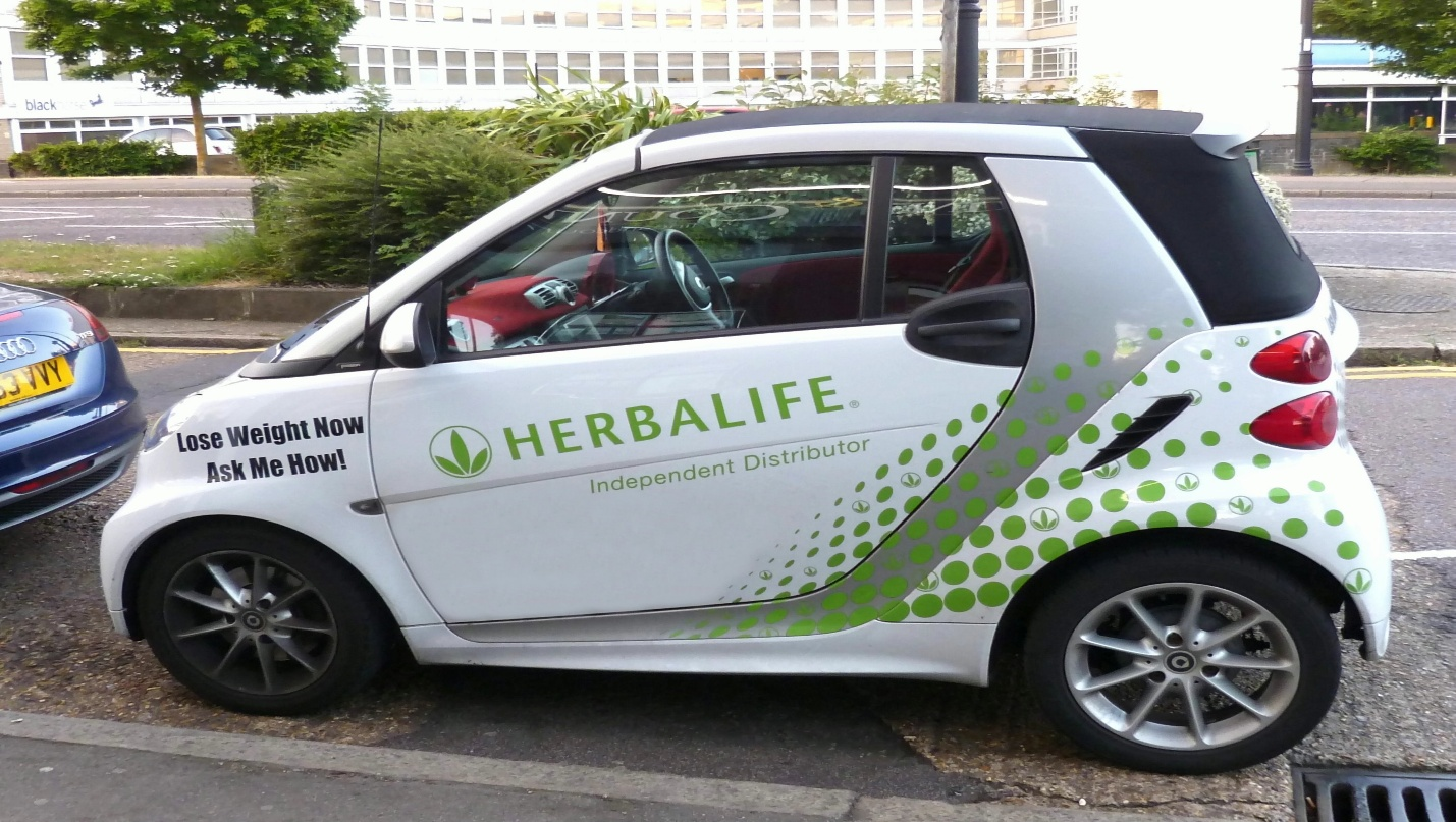 Car with herbalife label