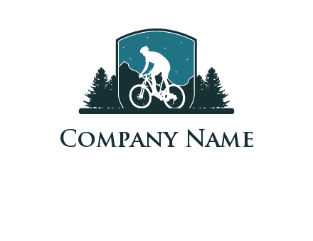 mountain biking in shield with trees emblem logo